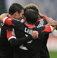 D.C. United midfielder Chris Pontius (13) celebrates his first goal with team mates in the 8th minute of the game.  D.C. United defeated The New York Red Bulls 4-1 at RFK Stadium, Sunday April 22, 2012.