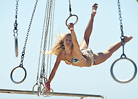 Aerospace Engineer Kara Sadlik, 26, swings at Santa Monica Muscle Beach.on Sunday, Aug 19, 2012.