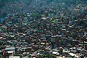 A partial view of the Rocinha favela. The biggest slum of Brazil built on a steep hillside overlooking the city, just one kilometre from the beach. Rio de Janeiro, Brazil, 2008