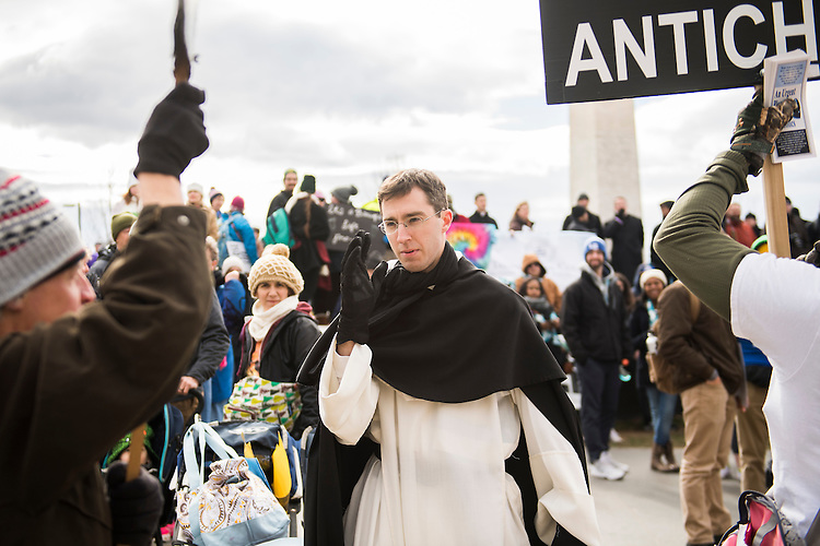 UNITED STATES - JANUARY 27: Fr. Athanasius Murphy offers a blessing to protesters during the speaking program of the annual March for Life, January 27, 2017. Attendees march from the monument to Capitol Hill to oppose abortion. (Photo By Tom Williams/CQ Roll Call)