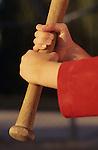Young girl (7 years old) close-up holding bat, sunset light, Tee ball,  Woodinville, Washington USA  MR