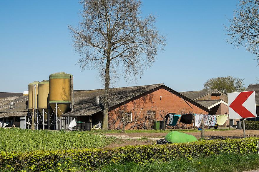Nederland, omgev. Boekel, 20 april 2015<br /> Grote stallen en voedersilo's in het brabantse landschap. <br /> <br /> Foto: Michiel Wijnbergh
