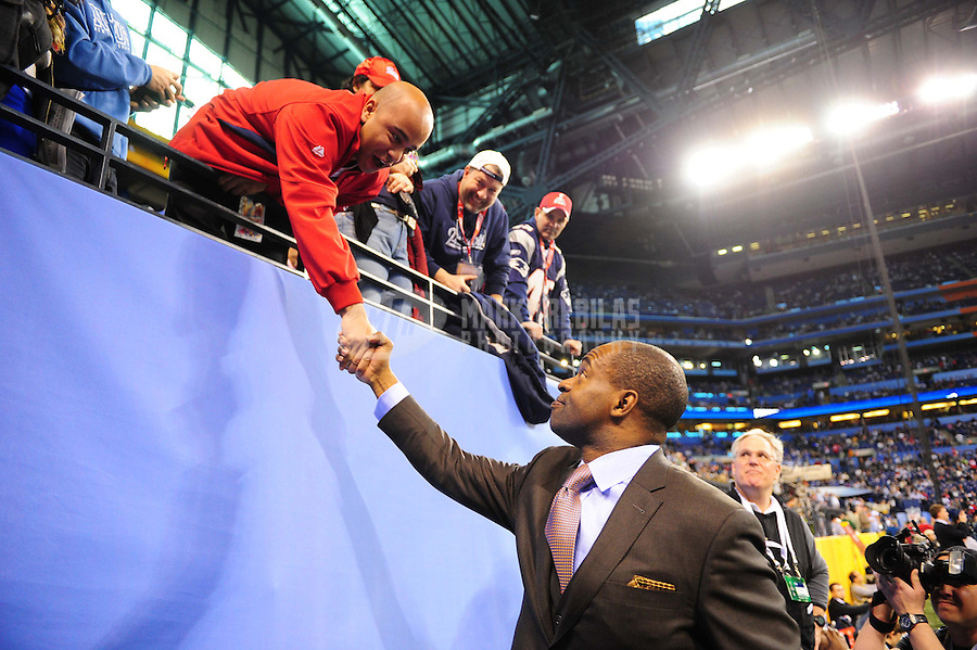 Feb 5, 2012; Indianapolis, IN, USA; NFLPA executive vice president DeMaurice Smith shakes hands with fans before Super Bowl XLVI between the New England Patriots and the New York Giants at Lucas Oil Stadium.  Mandatory Credit: Mark J. Rebilas-
