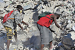 Haitians scavenge for anything of value in the devastated center of Port-au-Prince, Haiti, which was ravaged by a January 12 earthquake.