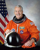 Houston, TX - (FILE) -- February 2, 2001 file photo of Astronaut John L. Phillips, mission specialist, STS-119, scheduled for launch no earlier than February 27, 2009.  Space shuttle Discovery will deliver the International Space Station's fourth and final set of solar arrays, completing the station's backbone, or truss structure.  The arrays will provide enough electricity to power science experiments and support the station's expanded crew of six. Altogether, the station's arrays can generate about 120 kilowatts of usable electricity -- enough to provide about 42 2,800-square-foot homes with power. The 14-day flight will include four spacewalks, lasting about 6.5 hours each, to help install the S6 truss segment to the right side of the station. STS-119 is the 125th space shuttle flight, the 28th flight to the station, the 36th flight of Discovery, and the first flight in 2009..Credit: NASA via CNP