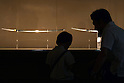June 26, 2010 - Tokyo, Japan -Visitors look at a long sword (katana) during The 1st Sword Craftsmen Exhibition of the NBSK (Nihon Bunka Shinko Kyokai) at Okura Musem of Art located in Okura Hotel in Tokyo, Japan, on June 26, 2010. The event runs from June 13 to July 25 and let sword masters show their skills such as sword polishing, sword fittings and mounting to visitors.