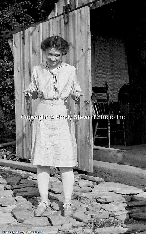 Erie PA:  Sarah Stewart showing off her morning catch before she fixes it for lunch - 1915.