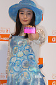 Actress Yukie Nakama shows KDDI au?s new mobile handset the spring season.  19 January, 2009. (Taro Fujimoto/JapanToday/Nippon News) TOKYO --<br /> <br /> Mobile carrier KDDI au on Thursday unveiled 12 new mobile handsets for the spring season. The new handsets are made by Sony Ericsson, Hitachi, Toshiba, Casio, Sharp, Panasonic, Kyocera for consumers and HCT for corporate users.