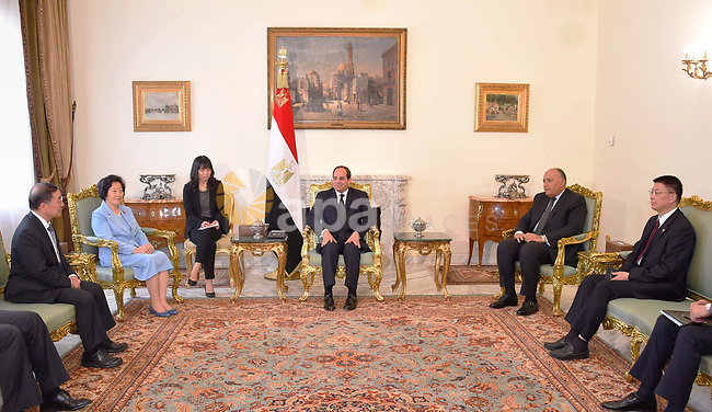 Egyptian President Abdel Fattah al-Sisi and Egyptian Foreign Minister Sameh Shoukry attend a meeting, in Cairo, Egypt, on April 13, 2017. Photo by Egyptian President Office
