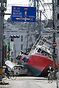 March 28, 2011, Ishonomaki, Japan - A fishing vessel, washed away by the tsunami, blocks the street of Ishinomaki, Miyagi prefecture, on Monday, March 28, 2011. Ishinomaki, an industrial port some 350km northeast of Tokyo, is one of the hardest-hit areas in northeast Japan by the March 11 magnitude 9.0 earthquake and the subsequent 10-meter tsunami. Much of the town still remains submerged in muddy waters, which have hampered the efforts of people searching for missing kin and reconstruction. (Photo by AFLO) [3609] -mis-