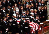 The casket containing the remains of former United States President Gerald R. Ford is carried by a military honor guard into the Washington National Cathedral, in Washington, D.C. on Tuesday, January 2, 2007. In the front row are: President George W. Bush,first lady Laura Bush,Vice President Dick Cheney, Lynne Cheney,former President Jimmy Carter, former first lady Roslyn Carter, and former first lady Nancy Reagan.  In the second row are former President George H.W. Bush, former first lady Barbara Bush, Doro Bush Koch, former President Bill Clinton, former first lady Senator Hillary Rodham Clinton (Democrat of New York), Chelsea Clinton, Secretary of State Condoleezza Rice, Secretary of the Treasury Henry M. Paulson, Jr., and Secretary of Defense William Gates.  Jack Ford looks on from far left.<br /> Credit: Ron Sachs / CNP<br /> [NOTE: No New York Metro or other Newspapers within a 75 mile radius of New York City]