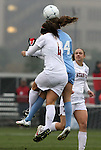 06 December 2009: Stanford's Alina Garciamendez (4) and North Carolina's Courtney Jones (84) challenge for a header. The University of North Carolina Tar Heels defeated the Stanford University Cardinal 1-0 at Aggie Soccer Stadium in College Station, Texas in the NCAA Division I Women's College Cup Championship game.