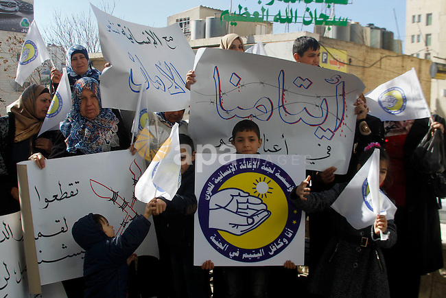 Palestinian orphans take part in a protest against the decision of Israeli occupation authorities to close the orphanage in the West Bank city of Hebron on Dec. 07, 2015. Photo by Wisam Hashlamoun
