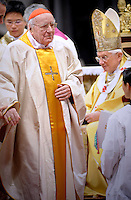 Pope Benedict XVI (L) gives his cardinal ring to Italian Domenico Bartolucci (R) during the Eucharistic celebration with the new cardinals on November 21, 2010 at St Peter's basilica at The Vatican. 24 Roman Catholic prelates joined the day before the Vatican's College of Cardinals, the elite body that advises the pontiff and elects his successor upon his death.