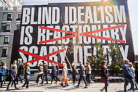 """Untitled (Blind Idealism Is...) by the artist Barbara Kruger on display along the High Line Park in New York on Sunday, March 27, 2016. The work is an adaptation of a quote from  philosopher Frantz Fanon which has been used in a number of the artists' works. (© Richard B. Levine)"