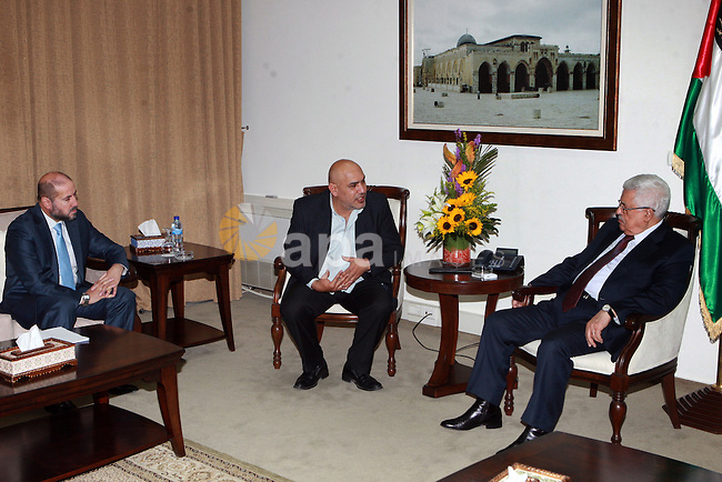 Palestinian President, Mahmoud Abbas (Abu Mazen)  meets with the director and film producer Rashid Mashharawi, in the West Bank city of Ramallah, on May 28, 2012.  Photo by Thaer Ganaim