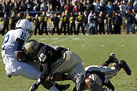 Purdue linebacker Anthony Heygood (42) puts a big hit on Penn State kick returner A.J. Wallace (12) during the opening kickoff. The Penn State Nittany Lions defeated the Purdue Boilermakers 12-0 on October 28, 2006 at Ross-Ade Stadium, West Lafayette, Indiana.