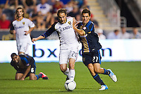 Ned Grabavoy (20) of Real Salt Lake battles for the ball with Zach Pfeffer (27) of the Philadelphia Union. The Philadelphia Union and Real Salt Lake played to a 0-0 tie during a Major League Soccer (MLS) match at PPL Park in Chester, PA, on August 24, 2012.