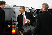 Chicago, IL - December 1, 2008 -- United States President-elect Barack Obama gets ready to board a flight to Philadelphia on Monday afternoon, December 1, 2008 at Midway Airport in Chicago, Illinois..Credit: Anne Ryan - Pool via CNP