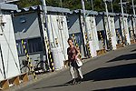 An unidentified woman walks through a temporary housing estate established for those who lost their homes during the March 11 quake and tsunami in Natori City, Miyagi Prefecture Prefecture, Japan on 08 Sept. 2011. Photograph: Robert Gilhooly