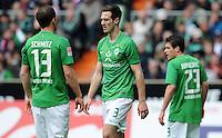 FUSSBALL   1. BUNDESLIGA   SAISON 2011/2012   32. SPIELTAG SV Werder Bremen - FC Bayern Muenchen               21.04.2012 Lukas Schmitz, Francois Affolter und Zlatko Junuzovic (v.l., alle SV Werder Bremen) sind enttaeuscht