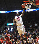 "Mississippi's Murphy Holloway (31) dunks against Arkansas' Mardracus Wade (1)  at the C.M. ""Tad"" Smith Coliseum on Saturday, January 19, 2013. (AP Photo/Oxford Eagle, Bruce Newman)"