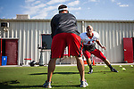 FRESNO, CA - AUGUST 11, 2014:   Fresno State linebacker Brandon Hughes works with strength coach, Joey Boese, during morning practice. CREDIT: Max Whittaker for The New York Times