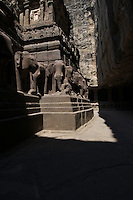 Kailash Temple at Ellora Caves Aurangabad, India.Kailash Temple, also Kailasa Temple is one of the 34 monasteries and temples, extending over more than 2km, that were dug side by side in the wall of a high basalt cliff in the complex located at Ellora, Maharashtra, India. Of these 34 monasteries and temples, the Kailasa (cave 16) is a remarkable example of Indian rock-cut architecture on account of its striking proportion; elaborate workmanship architectural content and sculptural ornamentation.. It is designed to recall Mount Kailash, the abode of Lord Shiva[2]. While it exhibits typical Dravidian features, it was carved out of one single rock. It was built in the 8th century by the Rashtrakuta king Krishna I..The Kailash Temple is notable for its vertical excavation-carvers started at the top of the original rock, and excavated downward, exhuming the temple out of the existing rock. The traditional methods were rigidly followed by the master architect which could not have been achieved by excavating from the front. The architects found to design this temple were from the southern Pallava kingdom..