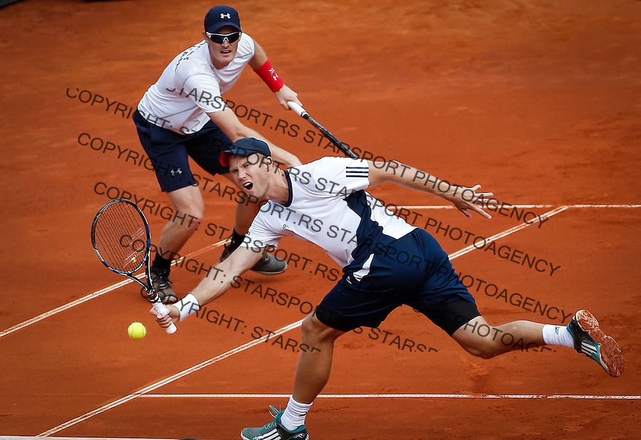 BELGRADE, SERBIA - JULY 16: Jamie Murray (L) and Dominic Inglot (R) of Great Britain compete in the doubles match against Nenad Zimonjic and Filip Krajinovic during day two of the Davis Cup Quarter Final match between Serbia and Great Britain on Stadium Tasmajdan on July 16, 2016 in Belgrade, Serbia. (Photo by Srdjan Stevanovic/Getty Images)
