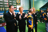 Steve Hart (Australia Under 19 Boys' coach) and Karen Denman, at the time CEO of the now-defunct Australian Indoor Cricket Federation, applaud the Australian team. <br /> 2003 Indoor Cricket World Masters and Under 19 Championships, Christchurch, New Zealand
