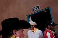 Cowboys are seen after riding in a parade celebrating the anniversary of the invasion of Pancho Villa in 1916in Columbus, New Mexico. Recently federal authorities arrested the mayor, police chief, and trustees who were allegedly operating an illegal gun running ring.