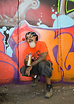 "Huntington, New York, U.S. 24th August 2013. INK76, street artist ALEXANDER SILVA from Brooklyn, is holding a spray paint can he used to help paint  the ""Art Matters"" wall, with legendary street artist SONIC BAD, on the back of the Huntington Arts Council building, during the the art event ""Off the Walls"" Block Party, by SPARKBOOM, a project the council created to help emerging artists, showcase talents, and help its artistic family network."