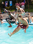 WATERBURY, CT- 3 August 2015-080315EC02-  From L to R: 12-year-old Ja-On Wright, 10-year-old Alex Rodriguez and 18-year-old Seth Surles jump into the pool at Fulton Park in Waterbury Monday afternoon. The city pool was packed as temperatures climbed toward 90 degrees. The pool closes for the season next week. Erin Covey Republican-American