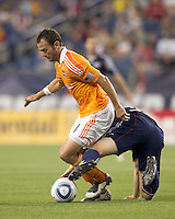 Houston Dynamo midfielder Brad Davis (11) dribbles under pressure. In a Major League Soccer (MLS) match, the New England Revolution tied Houston Dynamo, 1-1, at Gillette Stadium on August 17, 2011.