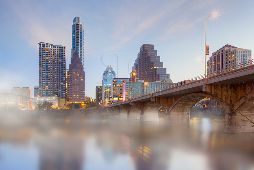 Fog covered the waters of Lady Bird Lake on this cold morning near Congress Bridge. Downtown Austin was coming to life just after sunrise in late January.
