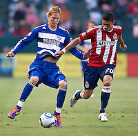 CARSON, CA – June 18, 2011: FC Dallas midfielder Brek Shea (20) attempts to shield Chivas USA defender Zarek Valentin (20) during the match between Chivas USA and FC Dallas at the Home Depot Center in Carson, California. Final score Chivas USA 1, FC Dallas 2.