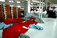 Finished garments dumped  at Popy's garment stitching factory in Tirupur, Tamilnadu. After lifting of quota system in textile export on 1st january 2005. Tirupur has become the biggest foreign currency earning town of India.