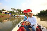 Brazil, on the Rio Para channel of the Amazon Delta, Professor Giorgio Venturieri brings the mini-hives of his design to different apiaries in a 150 km radius around Belém.