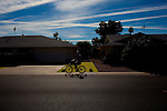 A cyclist and resident makes his way through Sun City, Arizona December 9, 2010. .2010 marks the 50th anniversary of Sun City, America's first retirement city that remains the largest today with more than 40,000 residents 55 and older.