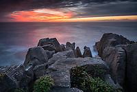 West Coast unset on Pancake Rocks, limestone formations in Punakaiki, Paparoa National Park, Buller Region, West Coast, New Zealand, NZ