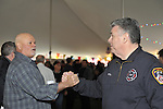 Fund raiser for firefighter Ray Pfeifer on Saturday, March 31, 2012, at East Meadow Firefighters Benevolent Hall, New York, USA. At left, Mike Wilson, a retired 159 Broolyn firefights, from Wantagh, shakes hands with Congressman Pete King (Republican - NY) after telling King he's grateful for everything the Representative does.