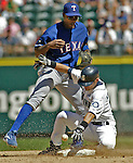Seattle Mariners Ichiro Suzuki breaks up a double play by forcing Texas Rangers second baseman Alfonso Soriano to drop the ball in the eight inning of their major league game at Safeco Field Sunday, July 3, 2005 in Seattle. Mariners Willie Bloomquist scored on the play as the Mariners beat the Rangers 2-1. Jim Bryant Photo