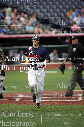 12 August 2011: Mike Mobbs returns to the dugout after slugging a homerun during a game between the Rockford River Hawks and the Normal Cornbelters at the Corn Crib in Normal Illinois.