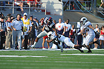 Ole Miss Donte Moncrief (12) is tackled by Southern Illinois cornerback James McFadden (24)  at Vaught-Hemingway Stadium in Oxford, Miss. on Saturday, September 10, 2011.