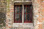 Europe, Belgium, Brugges. Glass bottle window.
