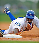 12 March 2008: Los Angeles Dodgers' center fielder Juan Pierre dives safely back to first base during a Spring Training game against the Washington Nationals at Holman Stadium, in Vero Beach, Florida. The Nationals defeated the Dodgers 10-4 at the historic Dodgertown ballpark. 2008 marks the final season of Spring Training at Dodgertown for the Dodgers, as the team will move to new training facilities in Arizona starting in 2009 after 60 years in Florida...Mandatory Photo Credit: Ed Wolfstein Photo