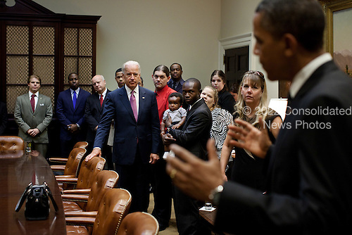 United States President Barack Obama and U.S. Vice President Joe Biden greet a group of teachers, veterans, first responders, and business owners in the Roosevelt Room of the White House before making a statement on the American Jobs Act, September 12, 2011. .Mandatory Credit: Pete Souza - White House via CNP