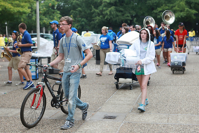 Jordan Jarvis unloads his bike as students move in to south campus dorms in Lexington, Ky., on Friday, August 23, 2013. Photo by Emily Wuetcher | Staff