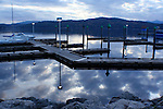 Lights reflect in the evening waters of Lake Coeur D Alene at the 4th St docks