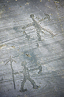 Prehistoric Petroglyph, rock carving, of what is known as a praying man carved by the Camunni people in the iron age between 1000-1600 BC, Seradina I rock 12, Seradina-Bedolina Archaeological Park, Valle Comenica, Lombardy, Italy